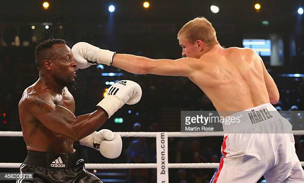 Leo Tchoula of Germany exchange punches with Stefan Haertel of Germany during the super middleweight fight at Sparkassen Arena on September 27 2014...