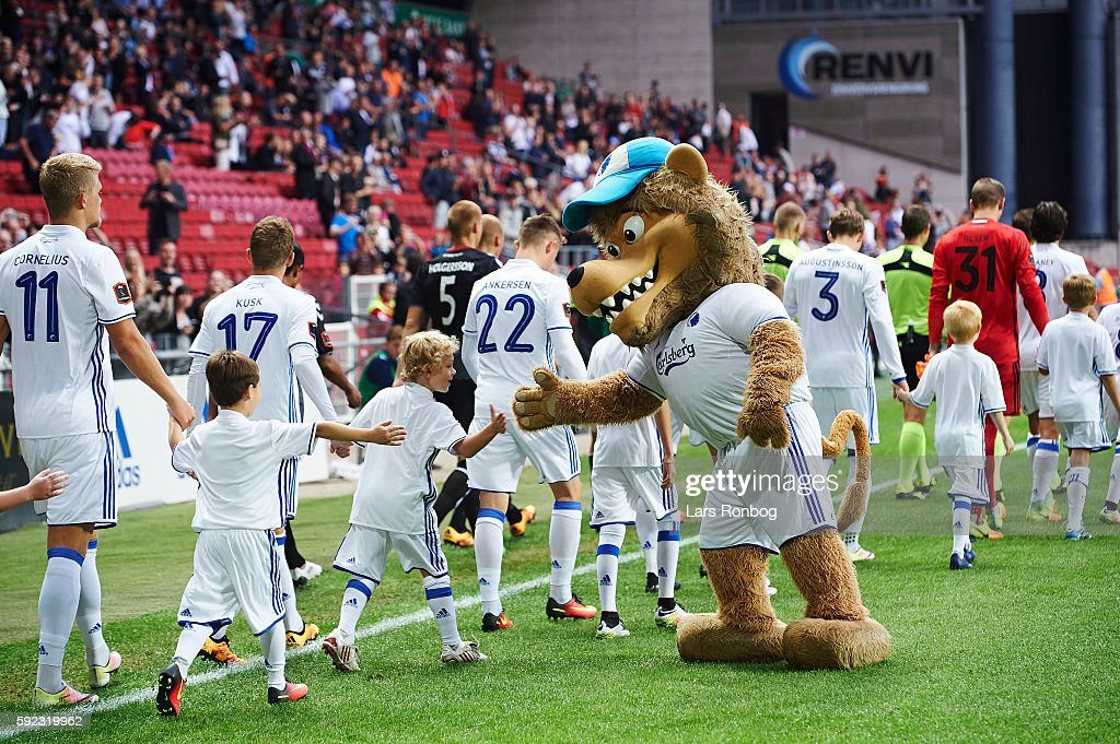 Leo the Lion shake hands with young mascots when the two teams walk on to the pitch prior to the Danish Alka Superliga match between FC Copenhagen...