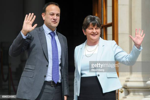 Leo Varadkar Ireland's prime minister and Arlene Foster leader of the Democratic Unionist Party wave to photographers at the Government Buildings in...