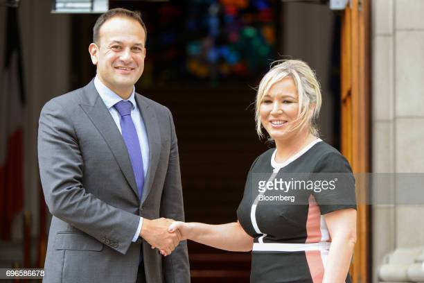 Leo Varadkar Ireland's prime minister left shakes hands with Michelle O'Neill leader of Sinn Fein at the Government Buildings in Dublin Ireland on...