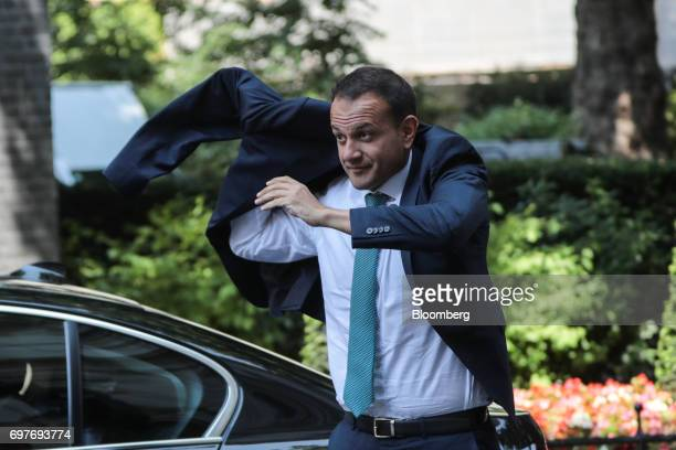 Leo Varadkar Ireland's prime minister puts on his suit jacket as he arrives for a meeting with Theresa May UK prime minister at Downing Street in...