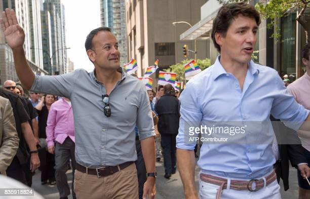 Leo Varadkar Taoiseach of Ireland left Canadian Prime Minister Justin Trudeau middle and Montreal Mayor Denis Coderre right walk along Boulevard...