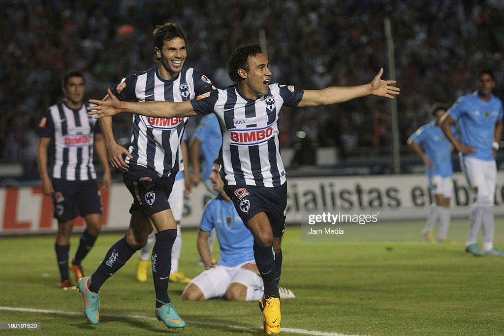 Leobardo Lopez and Jose Maria Basanta of Monterrey celebrate a goal against San Luis during a match between Monterrey v San Luis as part of the...