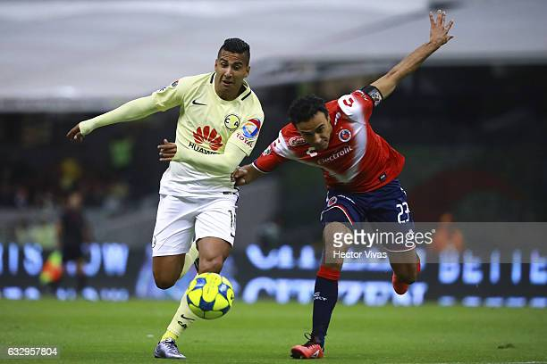 Leobardo Lopez of Veracruz struggles for the ball with Cecilio Dominguez of America during the 4th round match between America and Veracruz as part...