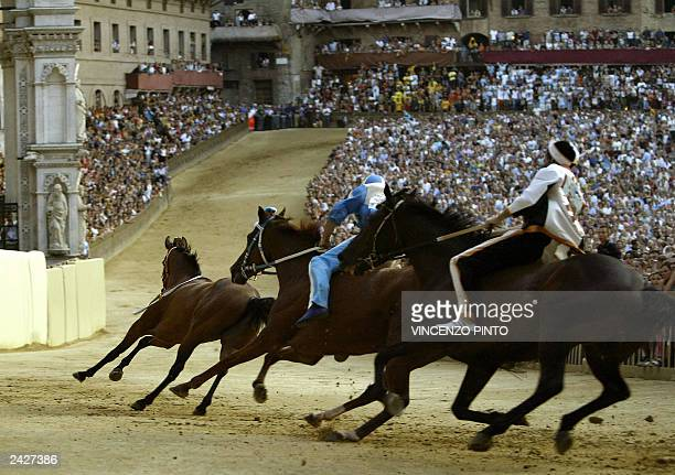 Leocorno's horse Brento takes the curve of San Martino followed by Onda parish horse Alghero and Lupa parish horse Baresi during a practice round in...