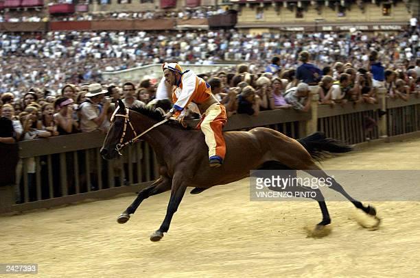 Leocorno's parish jockey Antonio Villella on his horse Brento takes the curve of San Martino during a practice round ahead of Siena's famous Palio...