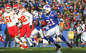 Leodis McKelvin of the Buffalo Bills runs past Cyrus Gray of the Kansas City Chiefs during the second half at Ralph Wilson Stadium on November 9 2014...