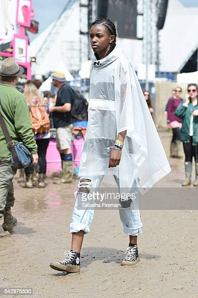 Leomie Anderson wears Converse at Glastonbury Festival 2016 at Glastonbury Festival Site on June 25 2016 in Glastonbury England