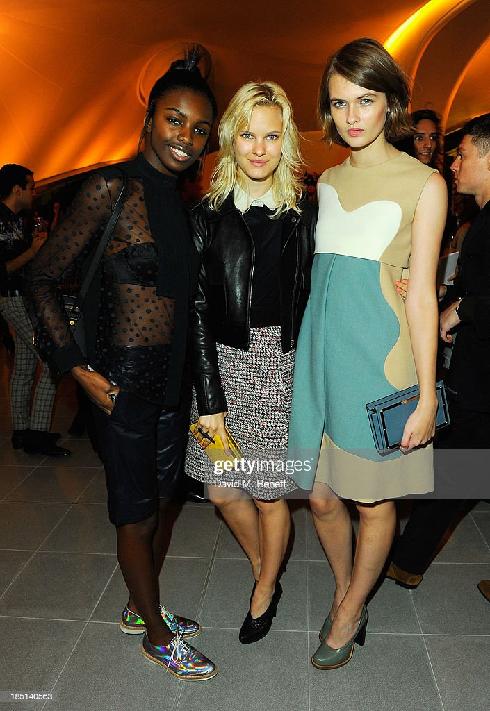 Leomie Anderson, Hannah Holman and Lara Mullen attend a cocktail party to Celebrate the Launch of the Book 'Chloe Attitudes' hosted by Sarah Mower and Marc Ascoli at Freer and Sackler Gallery on October 17, 2013 in London, England.