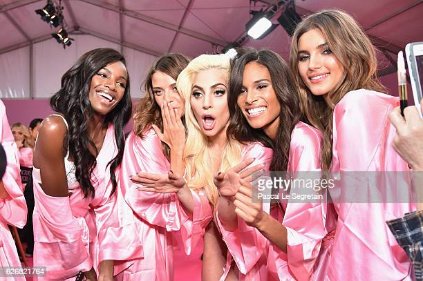 Leomie Anderson Lais Oliveira Lady Gaga Cindy Bruna and Valery Kaufman pose backstage prior to the Victoria's Secret Fashion Show on November 30 2016...