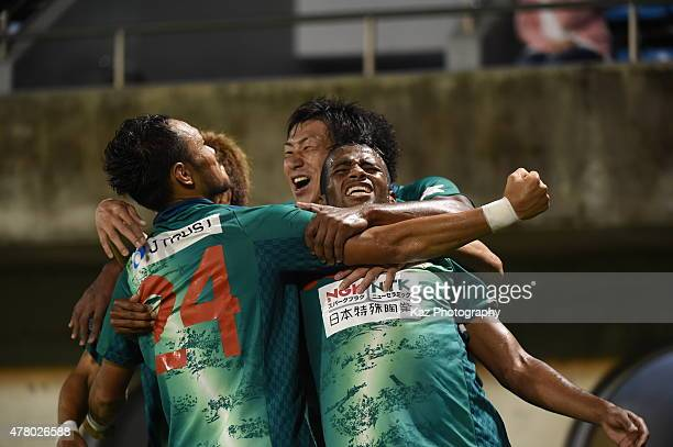 Leomineiro of FC Gifu who set up 3rd goal celebrated by his team mates Shun Nogaito and Hiroaki Namba of FC Gifu during the JLeague second division...