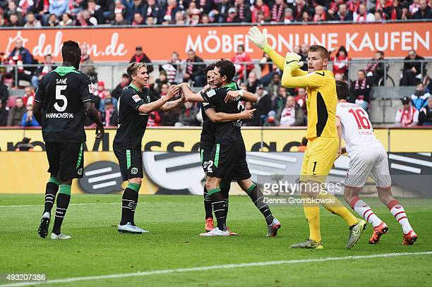 Leon Andreasen of Hannover 96 celebrates with team mates as he scores the opening goal during the Bundesliga match between 1 FC Koeln and Hannover 96...