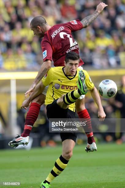 Leon Andreasen of Hannover and Robert Lewandowski of Dortmund battle for the ball during the Bundesliga match between Borussia Dortmund and Hannover...