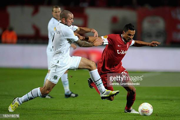 Leon Andreasen of Hannover challenges Nacer Chadli of Twente during the UEFA Europa League Group L match between Twente Enschede and Hannover 96 at...
