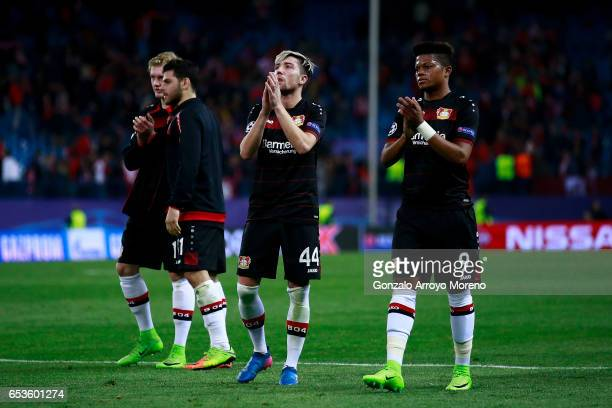 Leon Bailey of Bayer Leverkusen and his teammate Kevin Kampl acknowledge the audience their fans after the UEFA Champions League Round of 16 second...