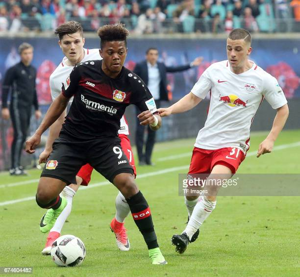 Leon Bailey of Leverkusen and Diego Demme of Leipzig battle for the ball during the Bundesliga match between RB Leipzig and Bayer 04 Leverkusen at...