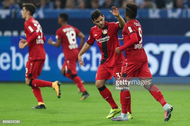 Leon Bailey of Leverkusen celebrates with Kevin Volland after scoring his team's firstt goal to make it 11 during the Bundesliga match between FC...