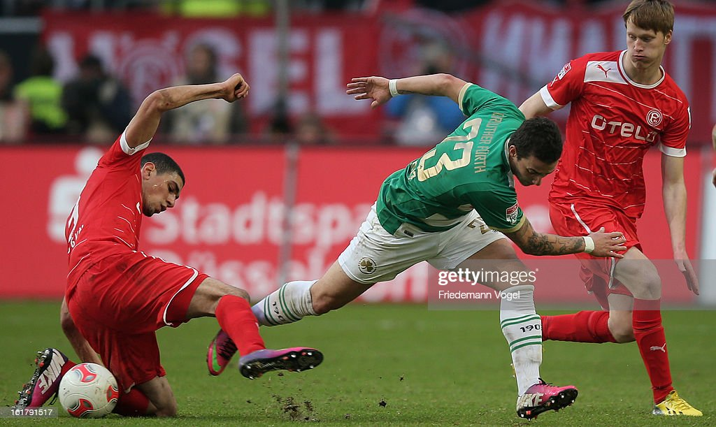 Leon Balogun (L), Gerrit Wegkamp (R) of Duesseldorf and Sercan Sararer (C) of Fuerth battle for the ball during the Bundesliga match between Fortuna Duesseldorf 1895 and SpVgg Greuther Fuerth at Esprit-Arena on February 16, 2013 in Duesseldorf, Germany.