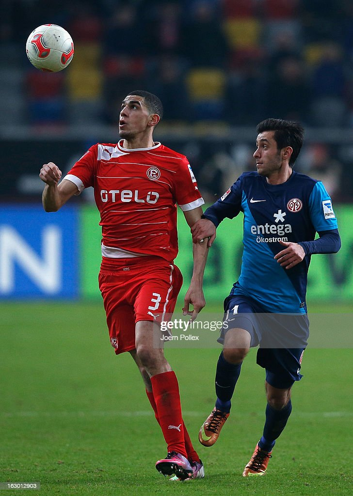 Leon Balogun (L) of Duesseldorf and <a gi-track='captionPersonalityLinkClicked' href=/galleries/search?phrase=Yunus+Malli&family=editorial&specificpeople=5532598 ng-click='$event.stopPropagation()'>Yunus Malli</a> of Mainz compete for the ball during the Bundesliga match between Fortuna Duesseldorf 1895 and 1. FSV Mainz 05 at Esprit-Arena on March 3, 2013 in Duesseldorf, Germany.