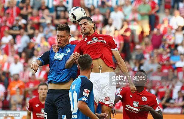 Leon Balogun of Mainz jumps for a header with Niklas Suele of Hoffenheim during the Bundesliga match between 1 FSV Mainz 05 and TSG 1899 Hoffenheim...