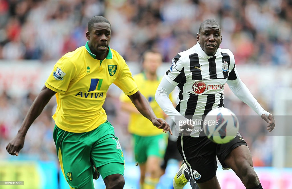 Leon Barnett (L) of Norwich City competes with Demba Ba of Newcastle United during the Barclays Premier League match between Newcastle United and Norwich City on September 23, 2012 in Newcastle, England.