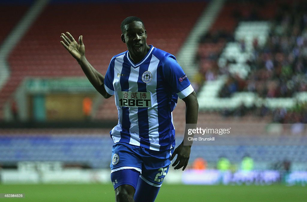 Leon Barnett of Wigan Athletic celebrates after scoring the first goal during the UEFA Europa League Group D match between Wigan Athletic and SV...