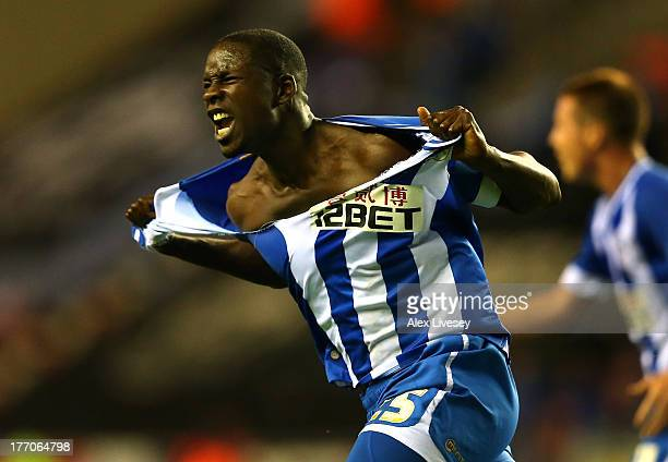 Leon Barnett of Wigan Athletic rips his shirt apart as he celebrates scoring the equalising goal against Doncaster Rovers during the Sky Bet...