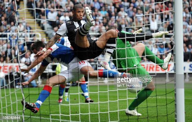 Leon Best of Newcastle tangles with Blackburn goal keeper Paul Robinson and defender Scott Dann as Demba Ba of Newcastle scores his team's third goal...