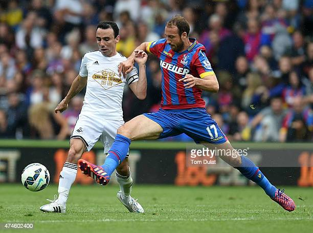 Leon Britton of Swansea City and Glenn Murray of Crystal Palace in action during the Barclays Premier League match between Crystal Palace and Swansea...
