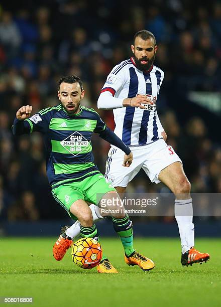 Leon Britton of Swansea City and Sandro of West Bromwich Albion compete for the ball during the Barclays Premier League match between West Bromwich...