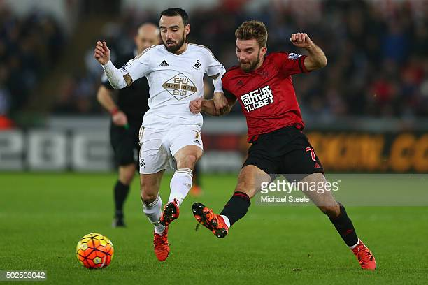 Leon Britton of Swansea City challenges James Morrison of West Bromwich Albion during the Barclays Premier League match between Swansea City and West...