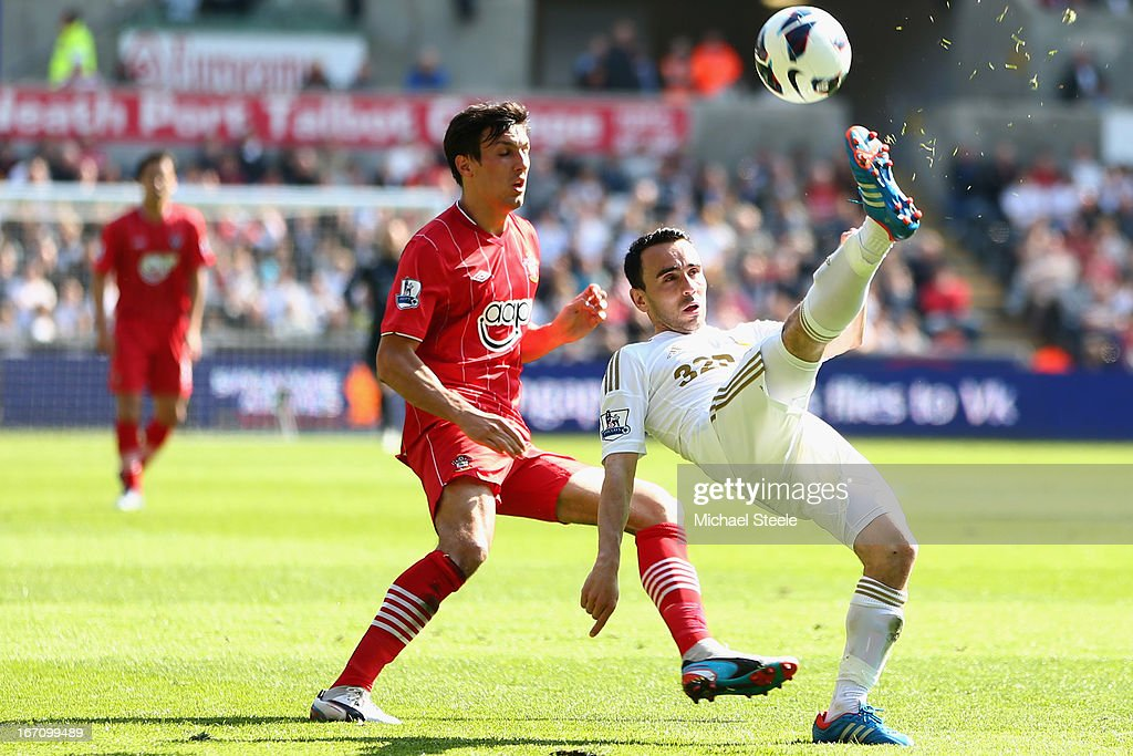 Leon Britton (R) of Swansea City clears from <a gi-track='captionPersonalityLinkClicked' href=/galleries/search?phrase=Jack+Cork+-+Soccer+Player&family=editorial&specificpeople=4206991 ng-click='$event.stopPropagation()'>Jack Cork</a> (L) of Southampton during the Barclays Premier League match between Swansea City and Southampton at the Liberty Stadium on April 20, 2013 in Swansea, Wales.