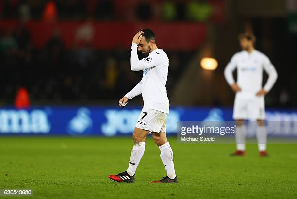 Leon Britton of Swansea City looks dejected after the Premier League match between Swansea City and West Ham United at Liberty Stadium on December 26...