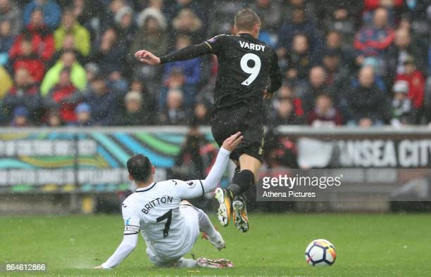 Leon Britton of Swansea City tackles Jamie Vardy of Leicester City during the Premier League match between Swansea City and Leicester City at The...