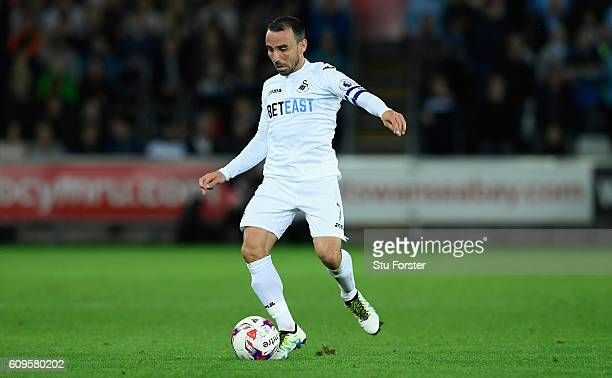 Leon Britton of Swansea in action during the EFL Cup Third Round match between Swansea City and Manchester City at the Liberty Stadium on September...