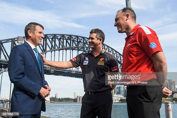 Leon Cameron and John Longmire greet NSW Premier Mike Baird during an AFL Finals launch at Sydney Opera House on August 30 2016 in Sydney Australia