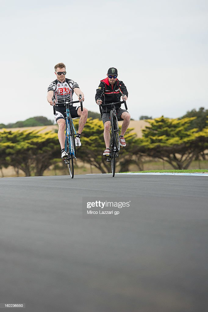 Leon Camier (L) of Great Britain and Crescent Fixi Suzuki and <a gi-track='captionPersonalityLinkClicked' href=/galleries/search?phrase=Eugene+Laverty&family=editorial&specificpeople=4253466 ng-click='$event.stopPropagation()'>Eugene Laverty</a> of Ireland and Aprilia Racing Team ride during the event 'Track lap on bicycles' during the round first of 2013 Superbike FIM World Championship at Phillip Island Grand Prix Circuit on February 21, 2013 in Phillip Island, Australia.