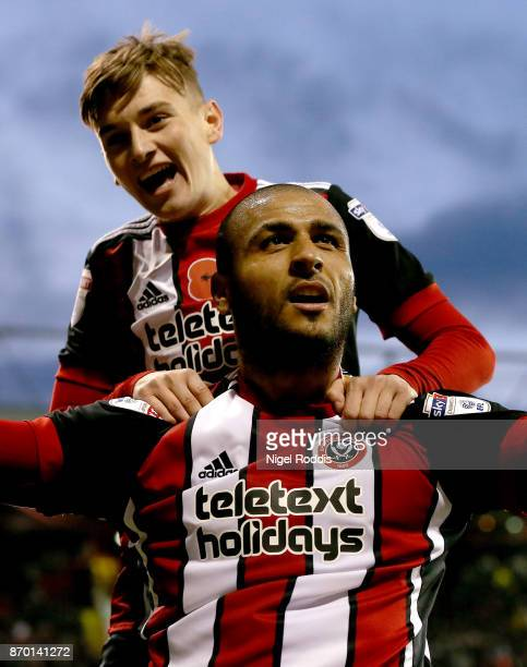 Leon Clarke of Sheffield United celebrates scoring his fourth goal with David Brooks during the Sky Bet Championship match between Sheffield United...