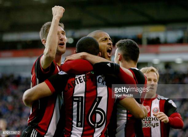 Leon Clarke of Sheffield United celebrates scoring with teamates during the Sky Bet Championship match between Sheffield United and Hull City at...
