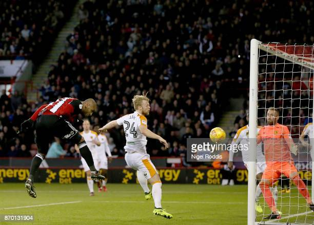 Leon Clarke of Sheffield United heads to score his third goal during the Sky Bet Championship match between Sheffield United and Hull City at Bramall...