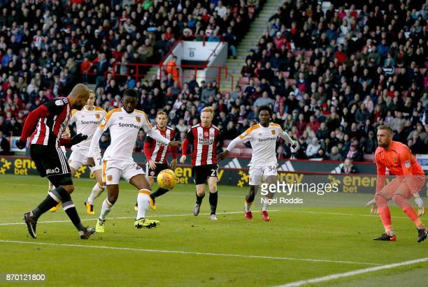 Leon Clarke of Sheffield United shoots to score during the Sky Bet Championship match between Sheffield United and Hull City at Bramall Lane on...