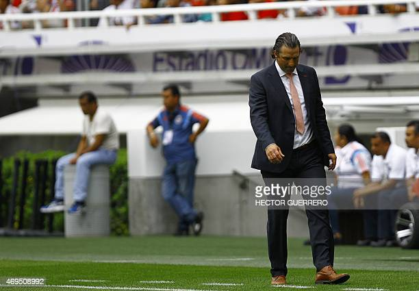Leon coach Juan Antonio Pizzi gestures during their Mexican Clausura 2015 tournament football match against Chivas at Omnilife stadium in Guadalajara...