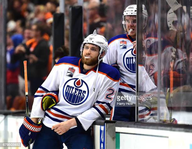 Leon Draisaitl and Connor McDavid of the Edmonton Oilers react as they leave the ice after a 43 loss to the Anaheim Ducks during the second overtime...
