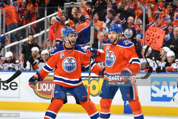 Leon Draisaitl and Darnell Nurse of the Edmonton Oilers celebrate after a goal in Game Six of the Western Conference Second Round during the 2017 NHL...