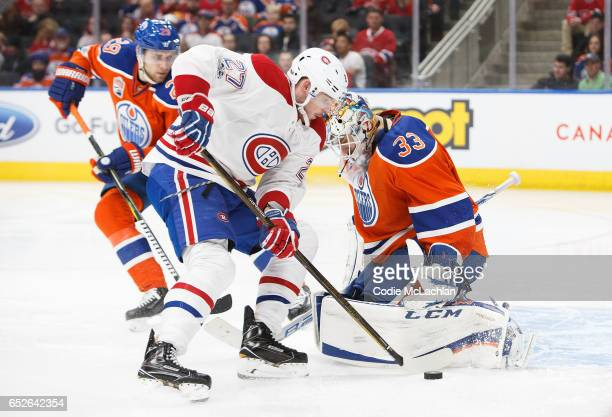 Leon Draisaitl and goalie Cam Talbot of the Edmonton Oilers protect the net from Alex Galchenyuk of the Montreal Canadiens on March 12 2017 at Rogers...