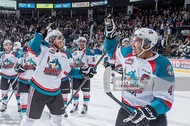 Leon Draisaitl and Madison Bowey of Kelowna Rockets celebrate the overtime win against the Portland Winterhawks at the end of game 5 of the Western...