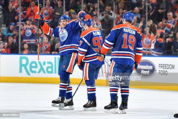 Leon Draisaitl Connor McDavid and Patrick Maroon of the Edmonton Oilers celebrate after a goal during the game against the Dallas Stars on March 14...