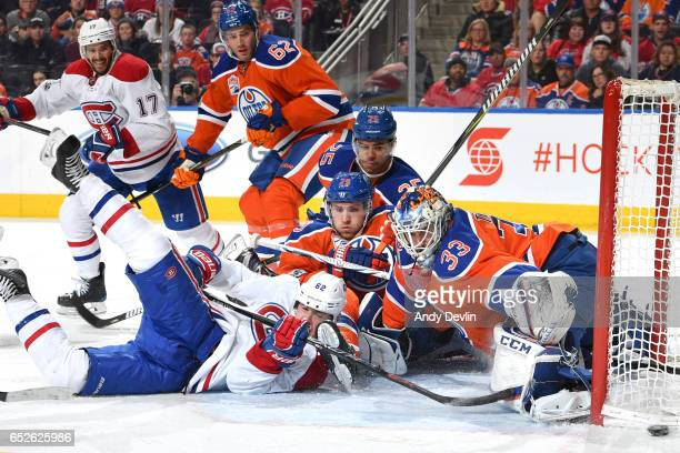 Leon Draisaitl Darnell Nurse and Cam Talbot of the Edmonton Oilers battle to keep the puck out against Artturi Lehkonen of the Montreal Canadiens on...