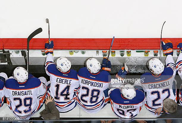 Leon Draisaitl Jordan Eberle Lauri Korpikoski Connor McDavid and Adam Cracknell of the Edmonton Oilers look on from the bench during third period...
