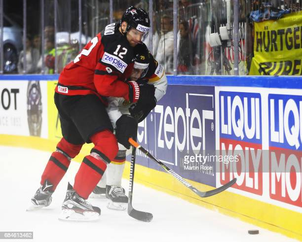 Leon Draisaitl of Germany is challenged by Colton Parayko of Canada during the 2017 IIHF Ice Hockey World Championship Quarter Final game between...